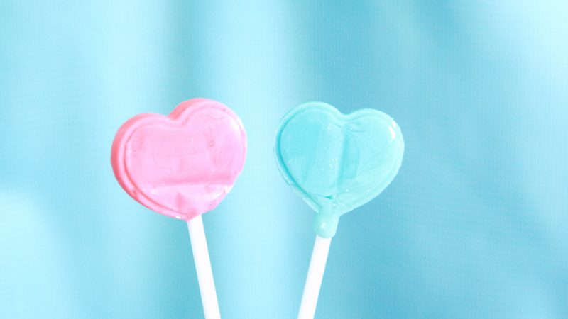 pink heart lollipop on white textile
