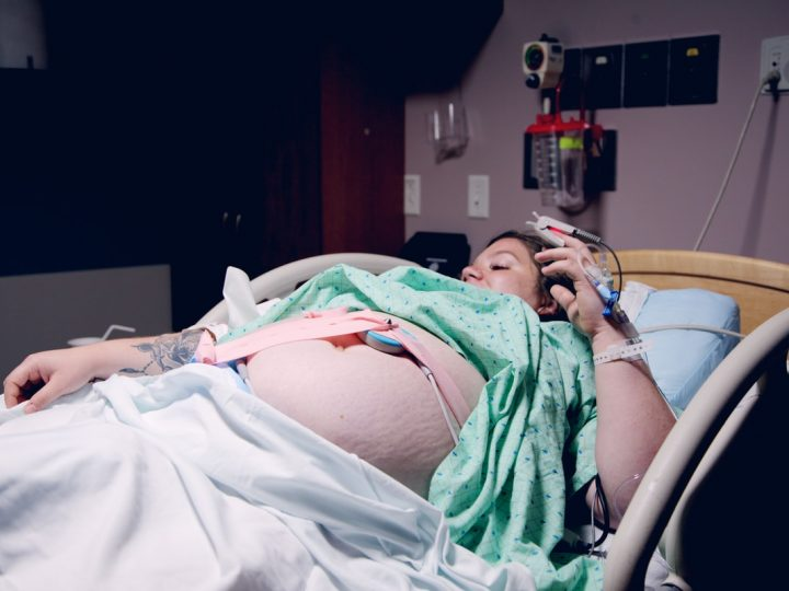 woman lying down in a hospital bed