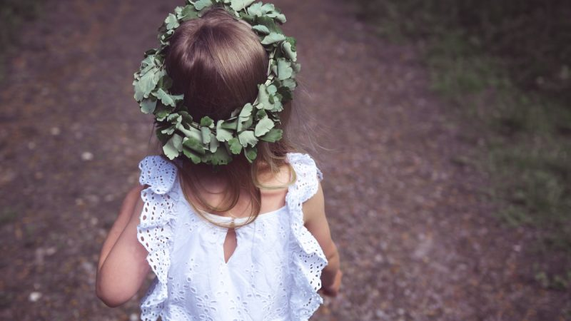 girl in white tank dress with green leaf crown